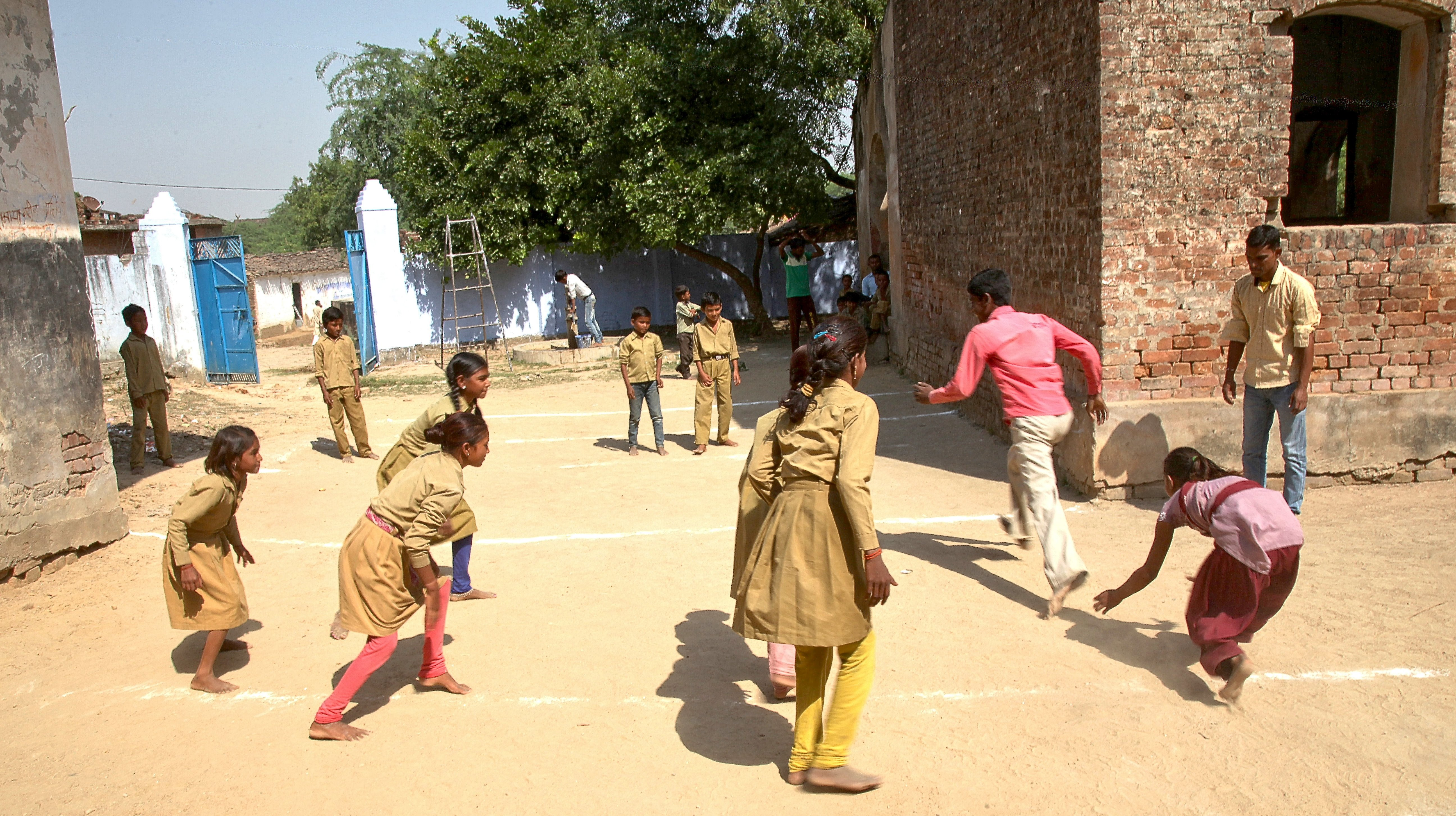 Both boys and girls joining sports activities in schools