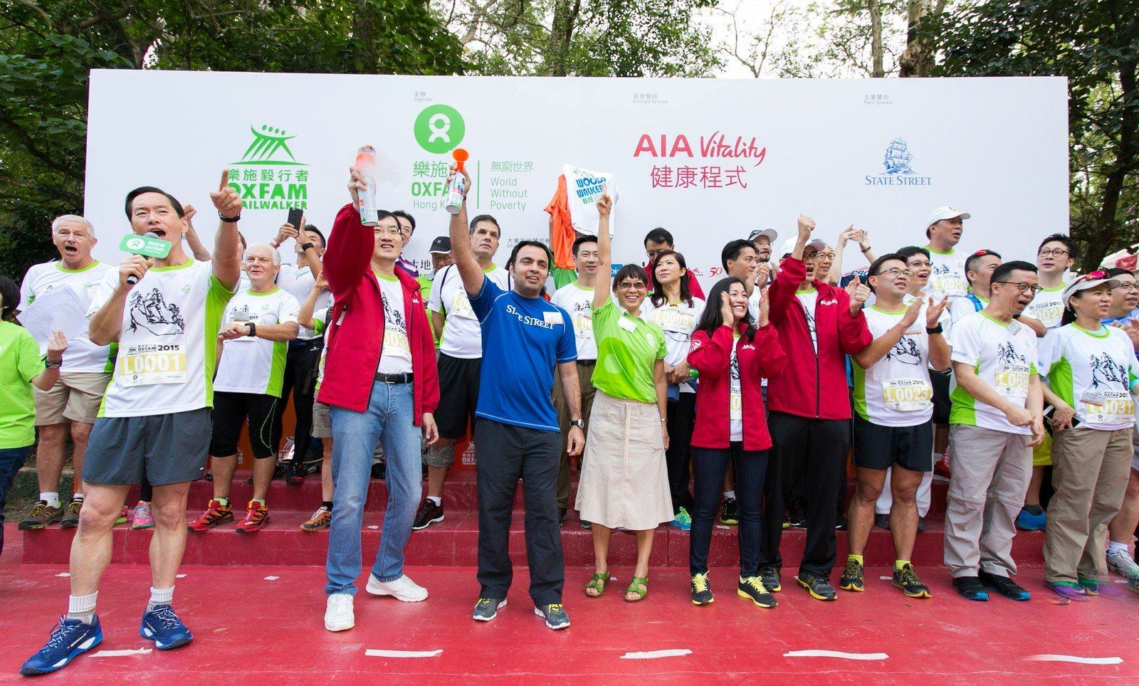 The Oxfam Trailwalker 2015 Kick-Off ceremony was officiated by Bernard Chan (front row first from the left), Oxfam Trailwalker Advisory Committee Chair, Jacky Chan, Chief Executive Officer, AIA Hong Kong and Macau, Principal Sponsor of Oxfam Trailwalker 2015, Syed Asim Hasan, Senior Vice President, State Street, and Trini Leung, Director General of Oxfam Hong Kong.