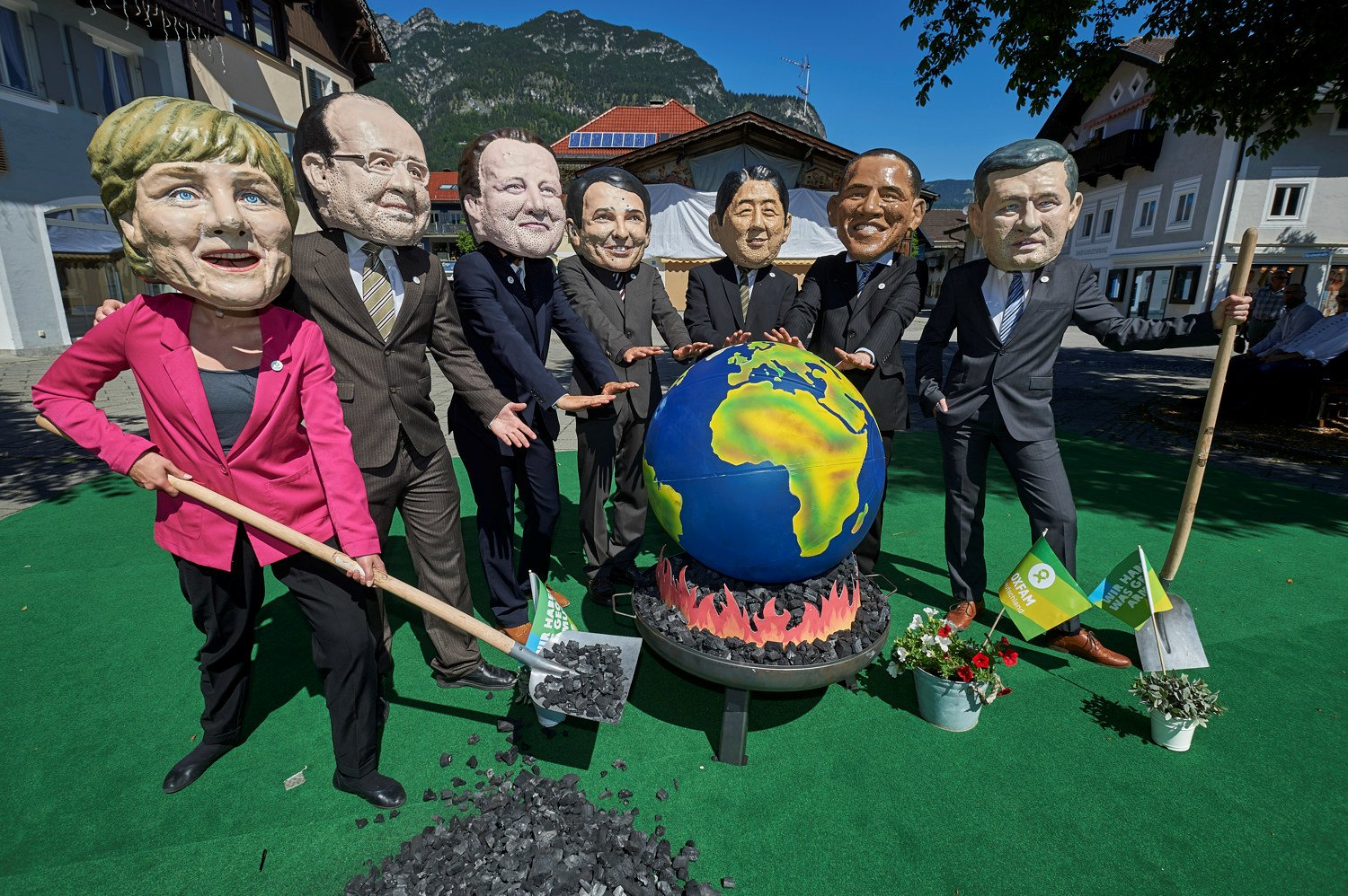 Oxfam is calling for G7 leaders, pictured barbecuing the planet at the G7 Summit, to kick their dirty coal habit.