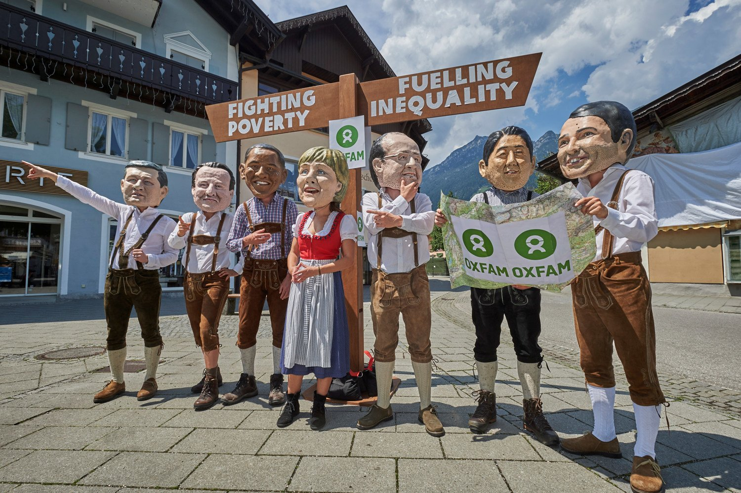 G7 leaders depicted with huge heads and kitted out with walking boots and maps must get on the right path to overcome poverty and inequality.