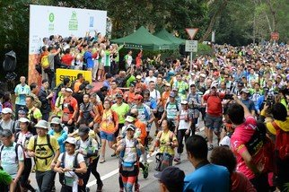 5,200 walkers are undertaking the 100 km challenge and will trek along the MacLehose Trail and other trails in teams of four within 48 hours.