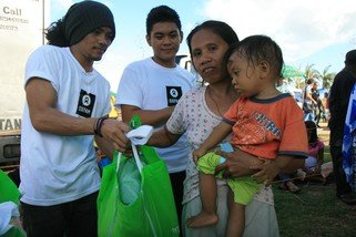 Dolor Moralde receives a hygiene kit from Oxfam. The hygiene kit contains soap, a blanket, clean underwear and toothbrushes.