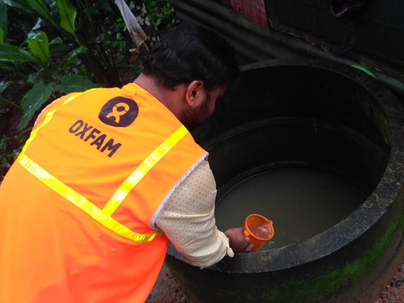 A member of Oxfam India's humanitarian team conducting a water quality assessment using water from a well. (Photo: Oxfam India)