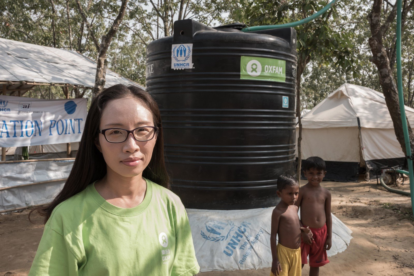 Kate Lee, Humanitarian Programme Officer at Oxfam Hong Kong, inspected the water tanks we built together with our partner organisations, as well as the water purification system in several refugee camps. (Photo: Ko Chung Ming/Oxfam)