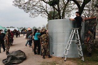 Oxfam has begun delivering aid to those affected by the earthquake by providing clean water, toilets and shelter. We have erected a water tank that can hold 11,000 litres of clean drinking water at the Tundikhel camp in Kathmandu. (Photo: Aubrey Wade / Oxfam)