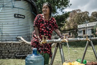 With roads and infrastructure badly damaged, it is difficult to obtain clean, potable water. Oxfam has installed a water tank in Tundikhel camp that can hold up to 11,000 litres of drinking water for survivors. (Photo: Pablo Tosco/Oxfam)
