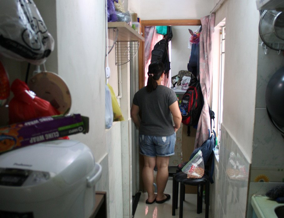 Yin, her husband and their 11-year-old son live in a subdivided flat.