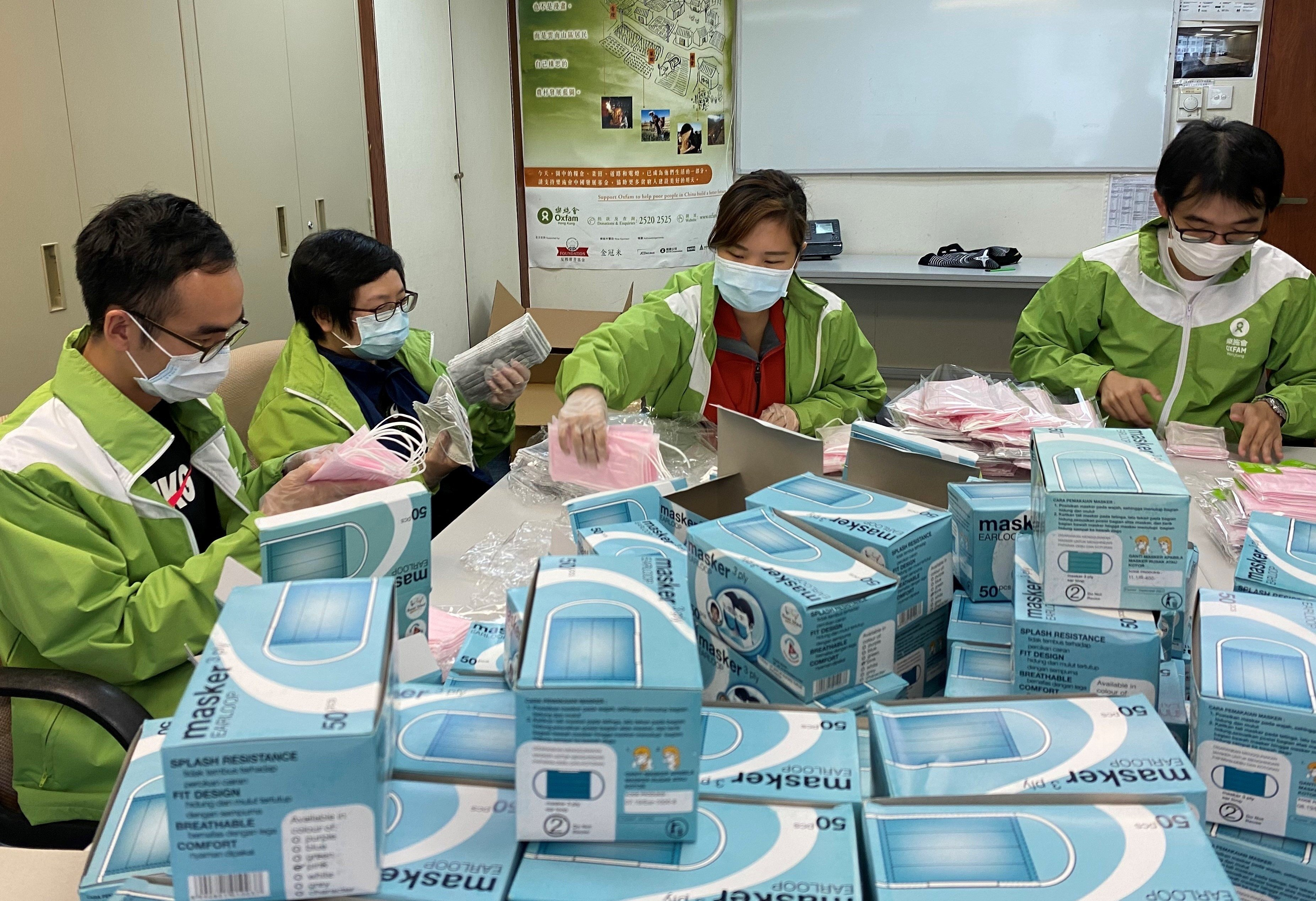 Oxfam staff packing masks