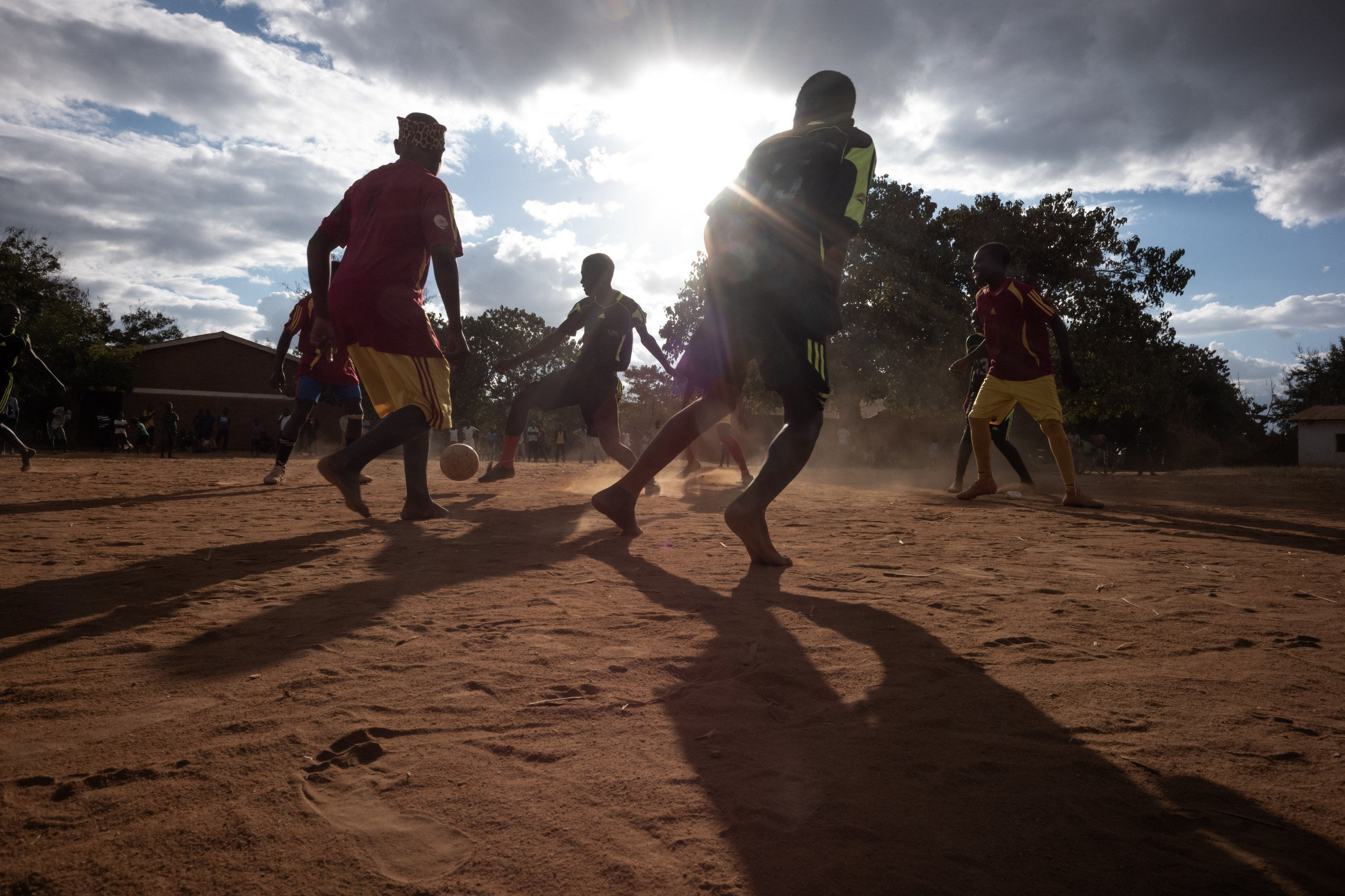 We bring boys and girls together to play football to encourage gender equity.