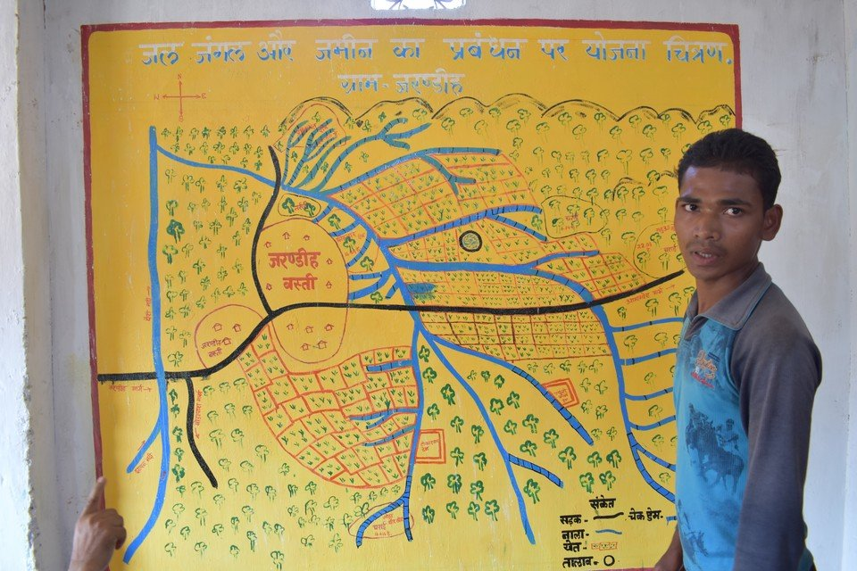 'If we protect the forest, the forest will provide all we need to secure our livelihood', said Charan Singh Sori, a youth undergoing GPS training, presenting how the village manages the community forest in front of the village resource map.